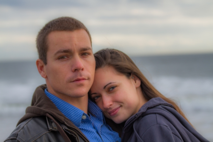 Photography session of happy engaged couple at Oak Island, beach,happy,romantic,best