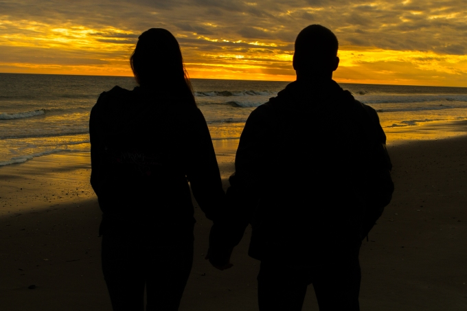 Photography session of happy engaged couple at Oak Island, beach,happy,romantic,best, siloutte